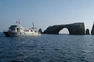 R/V Shearwater anchored next to Anacapa Island arch. Photo by Robert Schwemmer, NOAA ONMS.