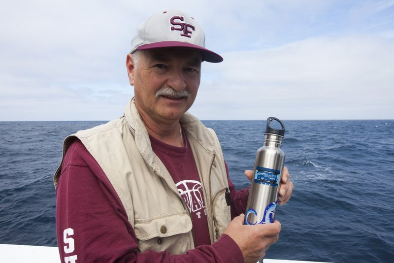 Using reusable water bottles, like this one from an Ocean Guardian School that chief scientist, Dr. Andrew DeVogelaere is holding, is one easy way to reduce trash in the oceans. (photo by Chad King)